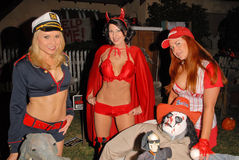 Alana Curry,Lisa Cash. Alana Curry, Jamie Carson and Lisa Cash preparing for the annual Halloween Bash at the Playboy Mansion, Private Location, Los Angeles, CA royalty free stock photography