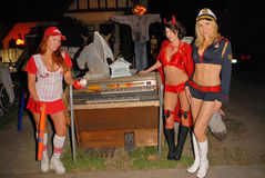 Alana Curry,Lisa Cash. Lisa Cash, Jamie Carson and Alana Curry preparing for the annual Halloween Bash at the Playboy Mansion, Private Location, Los Angeles, CA stock photography