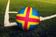 Aland Islands ball on corner kick position, soccer field background. National football theme on green grass.  stock images