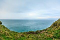 Alantic ocean and field of green grass, Ireland Europe. Atlantic ocean overcast sky and field of green grass, Ireland Europe royalty free stock images