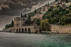 Alanya castle on the background of the ominous sky. A storm and dark clouds. Ottoman Shipyard view in Alanya royalty free stock photography