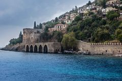 Alanya castle on the background of the ominous sky. A storm and dark clouds. Ottoman Shipyard view in Alanya royalty free stock photo