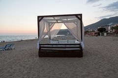 Alanya - The four-poster bed in the evening-scenery on the Cleopatra beach Royalty Free Stock Photos