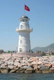 Alanya Lighthouse from The Sea. Famous Alanya Lighthouse located right across the red tower at the port Stock Photos