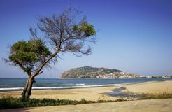Alanya peninsula view from beach. With oldest piratic fortress stock photos