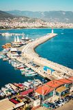 Alanya port surrounded by mountains. Seaside landscape. Lighthouse and boats. Touristic place Royalty Free Stock Image