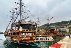 Pirate ships for tourists in the port of Alanya. Turkey. Alanya, Turkey - April 19, 2018: Pirate ships for tourist trips in the port Stock Images