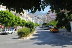Alanya, Turkey, July 2017: the central street of the city with a lively traffic on which many hotels are located Stock Image
