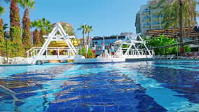 Alanya, Turkey - October 14, 2016: Animators entertain guests at swimming pool. Alanya, Turkey - October 14, 2016: Animators entertain guests at the swimming stock video footage