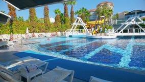 Alanya, Turkey - October 14, 2016: Animators entertain guests at swimming pool. Alanya, Turkey - October 14, 2016: Animators entertain guests at the swimming stock footage