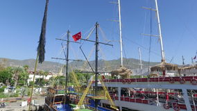 Alanya, Turkey - October 14, 2016: mast of ship and Turkish. Alanya, Turkey - October 14, 2016: The mast of the ship and Turkish flag flutters in the wind. Clear stock video footage