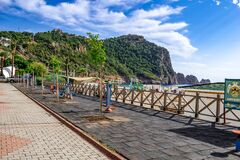Sports ground on the embankment in Alanya on the backdrop of a mountain with a castle. Row of