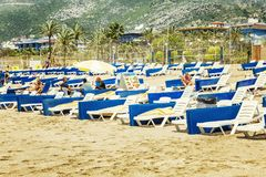 Alanya, Turkey, 05/07/2019: People relax on the loungers on the sandy beach. Horizontal stock image