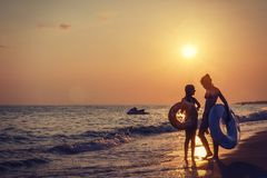 Alanya, Turkey - September 14, 2017: two young girls on sea bea. Ch at sunset stock photography
