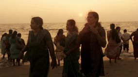 Alappuzha beach, south india, indian women contemplating sea stock footage