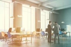Alaranjado e azul preside o canto de escritório tonificado Fotos de Stock Royalty Free