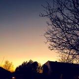 Alaranjado - por do sol do índigo Imagem de Stock