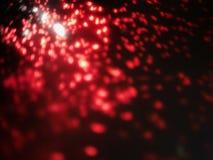 Alargamento da lente sumário da cor vermelha luz do bokeh no fundo preto fotografia de stock