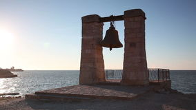 Alarm ancient bell on the bank of the Black Sea, Chersonese stock video footage