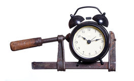 Alarm bell under pressure in clamp Royalty Free Stock Image