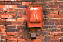 Alarm Box. View of old, broke alarm box on brick wall Royalty Free Stock Images