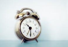 Alarm clock. An alarm clock ringing Stock Images