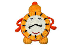 Alarm clock. Knitted handwork in the form of an alarm clock Royalty Free Stock Image