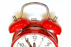 Alarm Clock. It's 5 to 12 on a alarm clock royalty free stock photography
