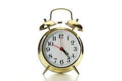 Alarm clock. An isolated brass alarm clock against a white back drop Royalty Free Stock Photography