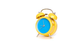 Alarm Clock. Yellow alarm clock close up, over white background royalty free stock photos