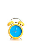 Alarm Clock. Yellow alarm clock close up, over white background stock photography
