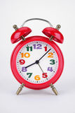 Alarm clock. Red alarm clock on a white background Stock Images