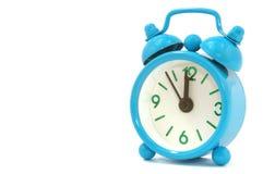 Alarm clock. Blue alarm clock on white background Stock Photography