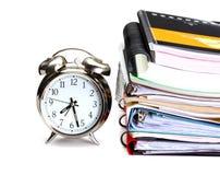 Alarm clock. Books, copy books and  folders on white background Stock Image