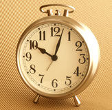 Alarm Clock. Silver Alarm Clock with brown background Royalty Free Stock Photo