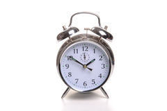 Alarm Clock. Photograph of an alarm clock shot in studio and isolated on a white background Stock Photo