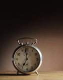 Alarm clock. Vintage alarm clock on table royalty free stock images