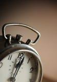 Alarm clock. Vintage alarm clock close up royalty free stock photos