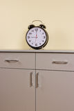 Alarm clock. On the chest of drawers Royalty Free Stock Photo