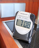 Alarm Clock. An alarm clock at a bedside in a hotel room Royalty Free Stock Photography