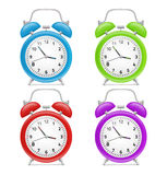 Alarm clock. Four colorful alarm clock Stock Photo