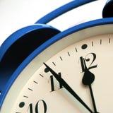 Alarm clock 3. Blue retro-style alarm clock showing five minutes to twelve stock photos
