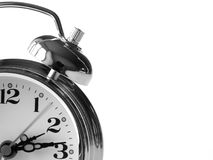 Alarm clock. Closeup of the round face and bell of a classic analogue alarm clock.  Black and white Royalty Free Stock Photography