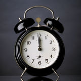 Alarm clock. Black alarm clock with reflection royalty free stock photo