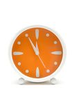Alarm Clock. Simple alarm clock showing five minutes to midnight. White background Royalty Free Stock Images