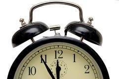 Alarm-clock. Five to twelve Stock Photography