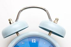 Alarm clock. Bells on top of light blue alarm clock Royalty Free Stock Image
