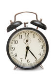 Alarm clock. Black alarm clock isolated on a white Stock Image
