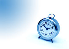 Alarm Clock. On white and light blue background stock photography
