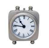 Alarm clock. Small alarm clock isolated on white Royalty Free Stock Photos